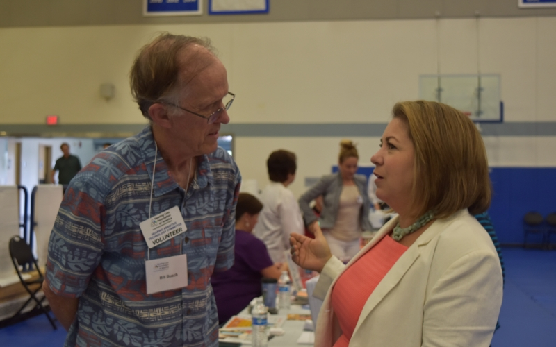 Congresswoman Sanchez speaks with a constituent at her Senior Fair.